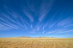 A classic Cirrus sky mirrors the desert below in Namibia.
