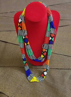 This is AFRCAIN, a multicolored ``sautoir`` necklace handmade from South Africa for you. Bead Embroidery Jewelry, Beaded Jewelry Patterns, Beaded Embroidery, Beaded Earrings, African Accessories, African Jewelry, Diy Crafts Jewelry, Bead Crafts, Seed Beads