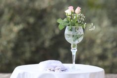 wedding decorations with tall vases anf full with roses