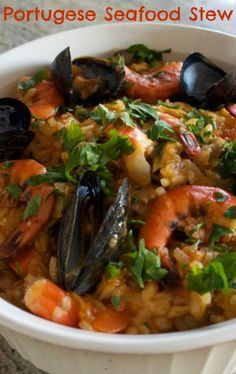 Arroz de Marisco - an amazing Portugese seafood stew made with short grain rice. Think of a cross between seafood paella (rice) and Italian cioppino (seafood stew) Read Recipe by motherwouldknow Pork Recipes, Fish Recipes, Great Recipes, Grilled Seafood, Fish And Seafood, Seafood Paella, Paella Food, Risotto, Portuguese Recipes