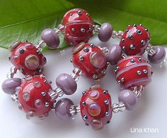 Lina Khan | Lampwork Beads: ACELYA - Red Rounds with bling Dots of Triton and Luna silver glass