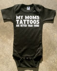 "Rockin Boy Onesie or Shirt ""My Moms Tattoos are Better Than Yours"". $13.00, via Etsy."