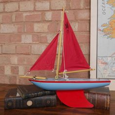 Vintage Toy Pond Yacht  // Evocative memories in a boat! This lovely 'Star' wooden toy yacht was made circa 1960's by iconic Star yachts of Birkenhead. Founded by Franz Denye, a Belgian refugee from the 1st World War. This SY 3 model is in beautiful condition, great bright colour and the deck transfer only has a slight bit of wear to it. This yacht is equally at home on display or on a pond.