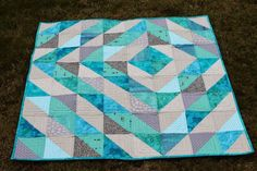 HSTs (Magic 8 Method) Baby Quilt using only Turquoise and gray