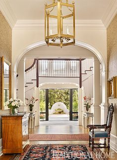 From the front door, the grand foyer extends straight to the back courtyard. - Photo: Emily Jenkins Followill / Design: Carolyn Griffith