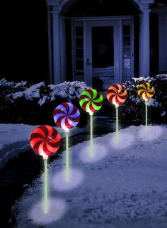 Battery Operated Candy Cane Light Show & Set of 4 Lighted Glittered Lollipop Path Stakes Christmas Yard Decor ...