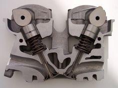 DOHC-Zylinderkopf-Schnitt - Overhead camshaft - Wikipedia, the free encyclopedia Boat Engine, Engine Block, Bugatti Veyron, Mécanicien Automobile, Honda, High Tech Gadgets, Combustion Engine, Motorcycle Engine, Cad Drawing