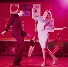 A young mod style couple dance together in a London nightclub circa 1965