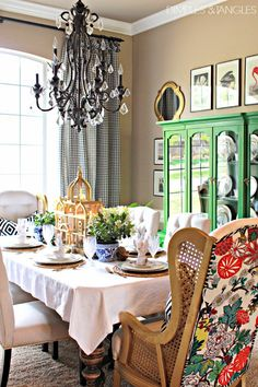 Golden Morocco shape mirror connecting the two different rows of small art work. BRIGHT Kelly Green china hutch.