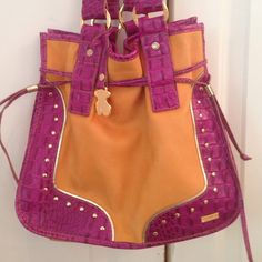 TOUS handbag  Gorgeous genuine TOUS handbag. Orange leather with magenta trim.... Hot pink lining. Rarely carried! In beautiful condition. Tous Bags