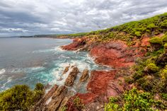 RUGGED Eden, New South Wales, Australia. Rugged is the best way I could describe this piece of coastline on the southern section of New South Wales' shores, and red is another word that could be used!  The lush growth along the cliff top makes way for a very dangerous rocky face against an equally threatening sea.  The red colour of the cliffs is amazing and in stark contrast to the other rocks in the water.