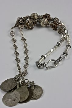"""Antique silver Yemenite beads with sterling silver beads from Sri Lanka and Bali and vintage Bedouin coins.  Sterling silver earrings with beads from Sri Lanka, to match.  Necklace measures approximately 18"""".  Found in the Rita Okrent Collection at RitaOkrent.com"""