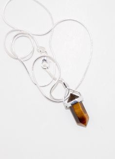 A personal favorite from my Etsy shop https://www.etsy.com/listing/261932489/golden-tiger-eye-point-set-in-sterling