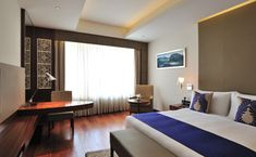 Check room rates & availability for Hotel Corporate Regency! Email Id: sales Call Us: Executive Room, India Design, Hotels Near, Working Area, Regency, Traveling By Yourself, Luxury, Bed, Furniture