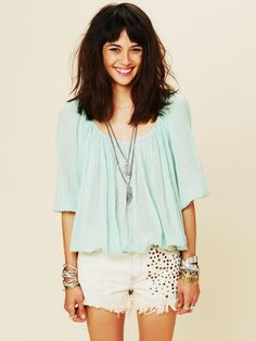 boho mint green top with edgy white skirt
