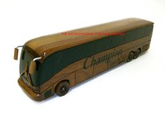 """A beautiful hand carved desktop model of a Coach. The model has been carved from solid mahogany. The model comes boxed and requires no assembly.  Size H 3"""", L 12"""", W 3"""". Visit our website at thewoodenmodelcompany.co.uk to view the full range of our models."""