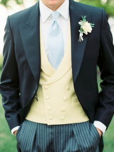 A preppy lemon yellow waistcoat for the groom: http://www.stylemepretty.com/maryland-weddings/stevensville-maryland/2015/11/20/classic-romantic-wedding-at-the-chesapeake-bay-beach-club/ | Photography: Krista A Jones - http://kristaajones.com/