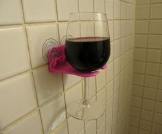 bathtub wine glass holder. Why do I not own this?!