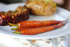 Glazed Whole Roasted Carrots; tender carrots glazed in a sweetly-tangy balsamic and honey glaze. Easy peasy delicious carrots!