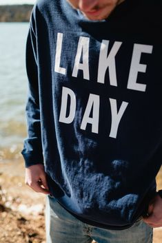 best website cf46e bb955 Perfect for chillier lake days, a heavyweight navy gray long sleeve shirt  featuring LAKE DAY