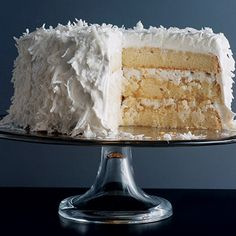 Nothing says festive as eloquently as a towering white coconut cake, and this particular one is breathtaking. Better yet, it's delicious—we've brushed each layer with a syrup made from coconut water and sugar to ensure that every bite is succulent. Shreds of delicate fresh coconut far surpass the packaged kind.