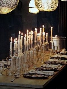 Elegant Halloween table lined with clear wine bottle candles. Love these candles for ANY party. Wine Bottle Candle Holder, Wine Bottle Centerpieces, Candle Centerpieces, Candle Holders, Centerpiece Ideas, Diy Centrepieces, Candle Arrangements, Floral Centerpieces, Chandeliers