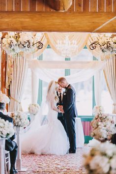 Indoor winter wedding #ceremony Photography: Dylan & Sara Photography - dylandsara.com Read More: http://www.stylemepretty.com/2014/05/19/rustic-glam-blush-pink-wedding/