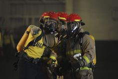 PACIFIC OCEAN (July 25, 2014) Sailors practice firefighting during a drill in the hangar bay of the aircraft carrier USS Nimitz (CVN 68). Nimitz is currently underway conducting routine training and exercises. (U.S. Navy photo by Mass Communication Specialist 3rd Class Siobhana R. McEwen/Released)