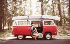 the red VW bus adds a playful element to this travel themed engagement session....we need a VW bus, so fun!