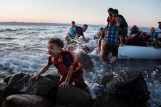 Andrew McConnell (b.1977) - A group of Syrians arrives on Lesvos after sailing on an inflatable raft from Turkey - 2012 Lesvos, Greece   ● https://foreignpolicyblogs.com/2016/03/28/lesvos-online-social-media-refugees-foreign-policy-individuals/ ● https://www.andrewmcconnell.com/Biography/1/