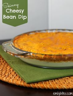 Hot and Cheesy Bean Dip - hearty and cheesy at just 106 calories or 3 Weight Watchers points for 1/3 cup! www.emilybites.com #healthy