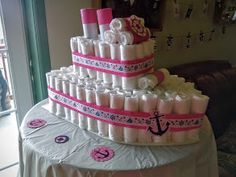 Diaper cake made to look like a ship for a nautical themed baby shower - so sweet in little girl colors!