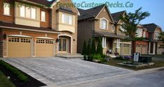 Driveway framed by contrasting colored brick. #interlocking #patio #landscaping #Toronto