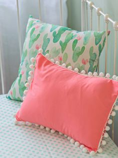 3-Piece Set: Pillow, Sheet, and 3-Sided Skirt Watercolor Cactus Blossoms crib bedding set for girls is a colorful girly take on the modern cactus trend.