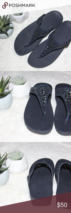 """NWOB Fitflop Navy Thong Sandal / Navy / Size 9 Faceted stones shimmer on a casually sophisticated sandal that puts comfort at a premium with FitFlop's signature Microwobbleboard™ midsole.  The innovative technology fuses three diagonal sections of triple-density EVA into a single, seamless, underfoot platform to absorb shock and diffuse high-pressure spots.  1 1/2"""" heel; 3/4"""" platform.  American Podiatric Medical Association (APMA) Seal of Acceptance.  Contoured footbed with arch support…"""