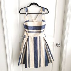 "*SOLD LOCALLY* Polo Ralph Lauren Fit-&-Flare Dress Like new! Purchased from Saks • Variegated stripes punctuate this tailored fit-&-flare design, accented with crisscross straps (adjustable) and dainty back buttons • square neckline • princess seams • seamed waist • side pockets • crisscross straps • back button detail • lined • about 22"" from natural waist • cotton/linen • dry  clean • Smoke/Pet free home •  No trades! Polo by Ralph Lauren Dresses"