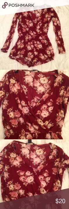 Forever 21 Floral Maroon Long-Sleeved Romper In great condition - only worn once!  Features a front snap enclosure so you have the option of cleavage or no cleavage 😉 Perfect to wear alone or pair with tights for cooler weather! Forever 21 Pants Jumpsuits & Rompers