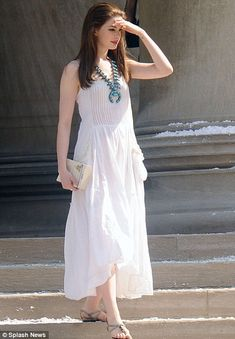 Floaty: Anne Hathaway in a long white dress in a break from filming the Dark Knight Rises.