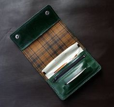 Handmade Leather Rolling Tobacco Case  Handmade tobacco Pouch Made from 2,5mm thickness high quality cowhide leather A uniquely designed. Clean cut, high quality,completely handmade. Hand stitched with same color waxed thread.  Dimensions : Full 26 cm x 15.5 cm Closed 9.5 cm x 15.5 cm