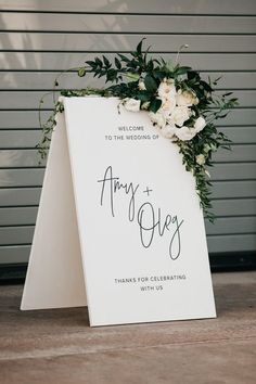 Elegant black + white wedding signage with lush floral accents | Image by Nicole Leever