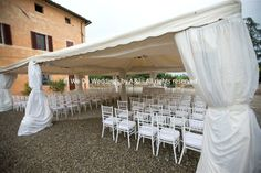 © We Do Weddings by A&J All rights reserved An amazing villa for weddings in Tuscany. On this occasion,  the couple followed our team advise and let us set up the elegant  marquee, which truly saved the day, as unfortunately it rained. Lovely shot by our official Tuscany photographer.