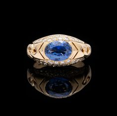 Bulgari 18k yellow gold ring features a 2.39 carat oval cut blue sapphire detailed with 0.56 carats of round brilliant diamonds.  Ring size is a 6 and can be resized.  Total weight of the ring is 9.5 grams.  CLICK PLAY ICON TO VIEW VIDEO