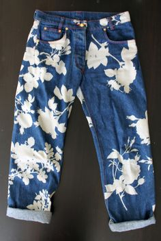 Vivienne Westwood denim jeans from 90s… featuring flower silhouettes, blocked out dyed, then uncovered, or bleached in, not sure…