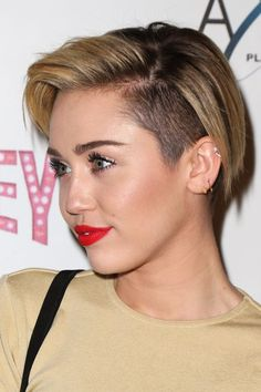 Miley Cyrus' Beauty Evolution Is Nothing Short Of Mesmerizing #refinery29  http://www.refinery29.com/2015/11/98068/miley-cyrus-makeup-beauty-looks#slide-16  December 2013In one of our favorite looks from this slideshow, Cyrus mastered a glowy complexion and is at the top of her brow and red lip game. Her hair color is soft and is the perfect length to show off her on-trend undercut....