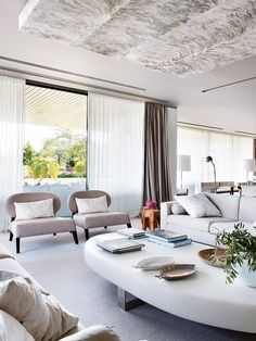 Living room ideas. Oversized coffee table. Curtains. Grey chairs. Manic Modernism