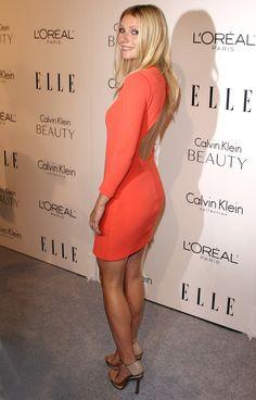 Gwyneth Paltrow gorgeous in a curve hugging orange dress