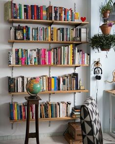 Few things look better paired together than a full bookshelf and a globe