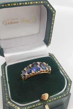 If you receive this mesmerising five stone sapphire half hoop ring, get ready to be blown away everyday with its beauty! The five oval shaped sapphires are a deep velvety blue and were hand selected so that either side graduates in size equally. The hand carved half hoop ring also has eight diamond points that add extra detail and sparkle to the ring. #SapphireRing #SapphireEngagementRing #HalfHoopRing #VictorianRingDesign Victorian Era, Victorian Fashion, Victorian Engagement Rings, Diamond Point, Dress Rings, Ring Designs, Bracelet Watch, Hand Carved, Hoop