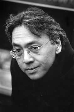 "KAZUO ISHIGURO (b. 1954), Japanese-British novelist: Son of a Japanese oceanographer who grew up in Shanghai, his family moved from Japan to England when he was 5. Though planning to stay only a few years, they remained long-term. He attended English school, but at home they spoke Japanese & incorporated their Japanese roots. He said his writing started in attempt to preserve his fading memories of Japan. His books, include ""Remains of the Day,"" ""Never Let Me Go,"" & ""When We Were Orphans.""…"