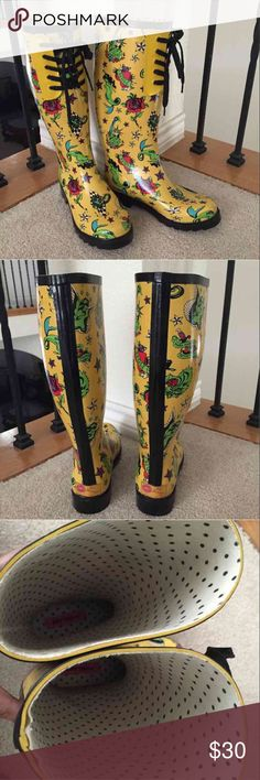Betsey Johnson Tattoo Rain Boots size 6 Betsey Johnson rain boots with tattoo art design by Mark Mahoney. These boots are a little too small for me so I'm selling them. They have been used so there are some scuffs. I am not the original owner of these. Still in great condition. Yellow with multi color stars, roses, mom heart, mermaids, Statue of Liberty guys, and other stuff. Size 6. Black laces on the front. White and black polka dot design inside. Betsey Johnson Shoes Winter & Rain Boots